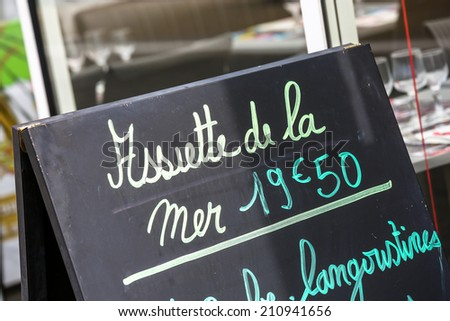 Closeup on menu board outside a French restaurant - stock photo