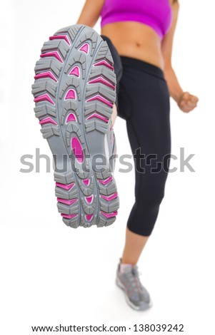 Closeup on sole of fitness young woman kicking - stock photo