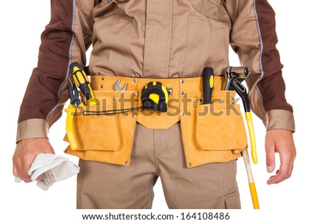 Closeup on the tool belt of worker on white background - stock photo