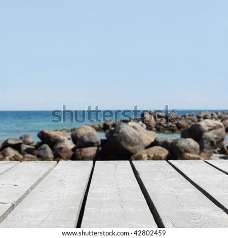 Closeup on the wooden pier - stock photo