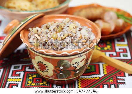 Closeup on traditional Christmas kutia dish in the traditional towel - stock photo