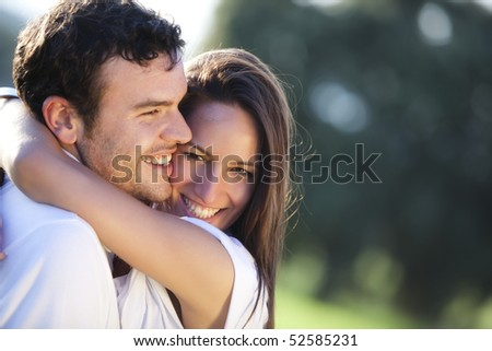 Closeup on young beautiful smiling couple. - stock photo