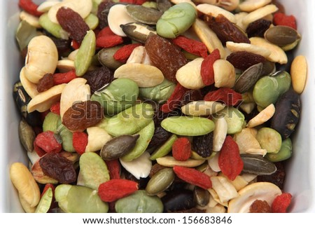 closeup organic mixed nuts and dry fruits  - stock photo