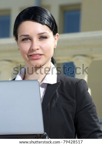 Closeup outdoor portrait of businesswoman with laptop - stock photo