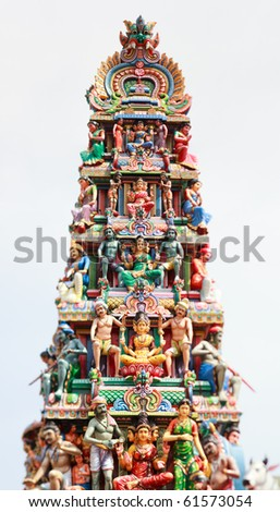 Closeup panorama of Sri Mariamman Hindu Temple roof in Singapore taken with tilt and shift lens - stock photo