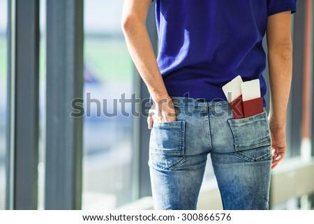 Closeup passports and boarding pass at airport indoor - stock photo