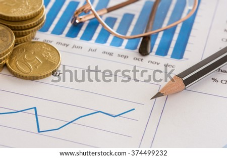 Closeup pen on financial graph report with money on desk's manager. concept of finance background, finances, finance business. - stock photo