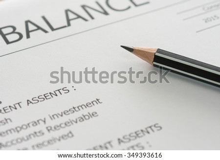 closeup pencil on balance sheet on accountant's desk. soft focus. accounts concept. - stock photo
