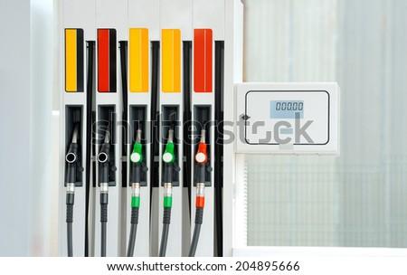 Closeup petrol pump gas station - stock photo
