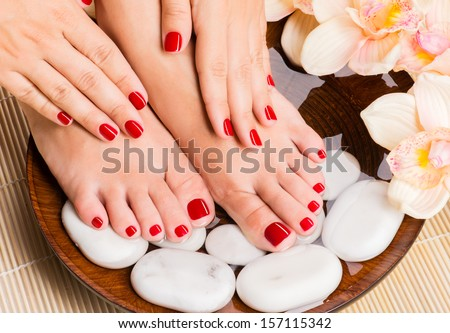 Closeup photo of a beautiful female feet at spa salon on pedicure procedure - stock photo