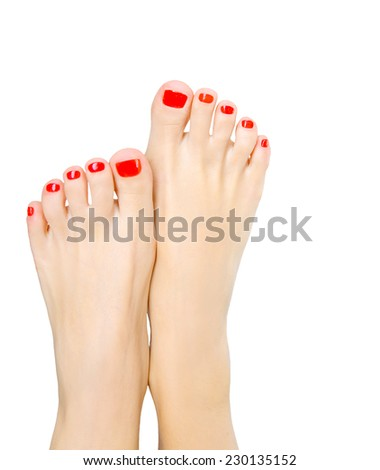 Closeup photo of a beautiful female feet with red pedicure isolated on white background - stock photo