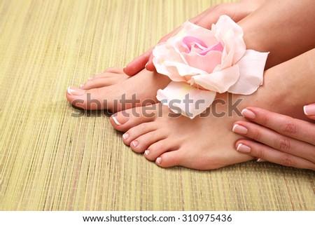 Closeup photo of a female feet at spa salon on pedicure procedure - stock photo