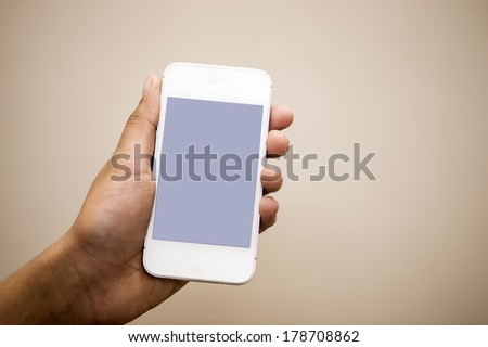 closeup photo of a hand holding cell phone  - stock photo