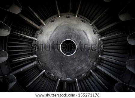Closeup photo of a jet engine - stock photo
