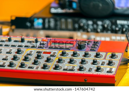 Closeup photo of an audio mixer in a studio - stock photo