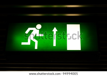 Closeup photo of an exit sign in the metro - stock photo