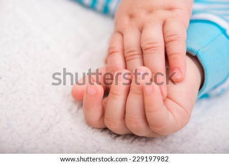 closeup photo of baby hands - stock photo