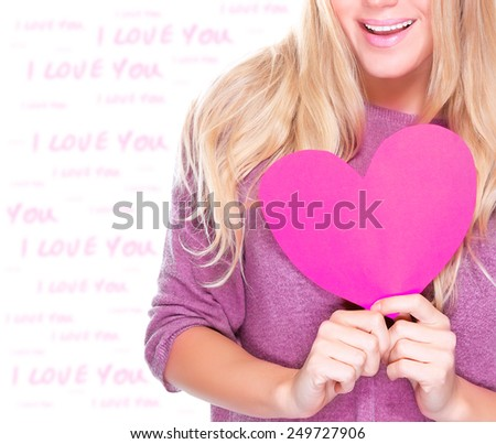 Closeup photo of body part of cute blond woman holding in hands pink paper heart, romantic feelings, happy Valentine day decoration  - stock photo