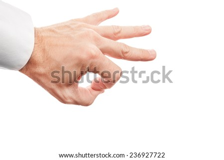 Closeup photo of business man hand preparing flick with his index finger isolated on white background Click on the head with his index finger - stock photo