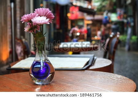 Closeup photo of cafe table outside in Shanghai - stock photo