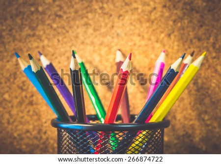 Closeup photo of colorful pencils on woode background - stock photo