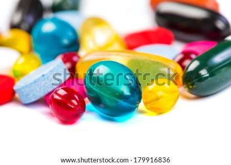 Closeup photo of colorful pills on isolated white background