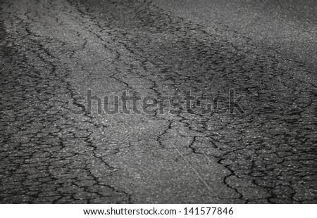 Closeup photo of damaged asphalt road - stock photo