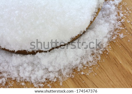 Closeup photo of fine Magnesium sulfate powder, also called Epsom salts in wooden bowl  on wooden background - stock photo