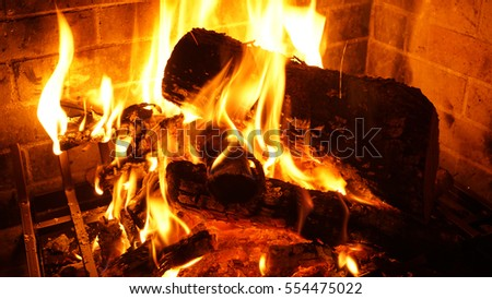 Closeup photo of fire in a cosy fireplace