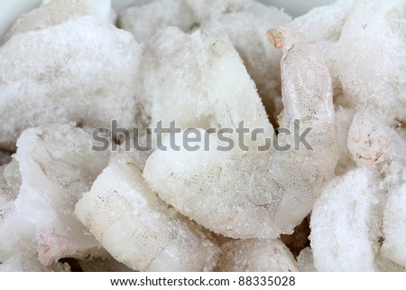 Closeup photo of large size of frozen raw shrimp with tail removed
