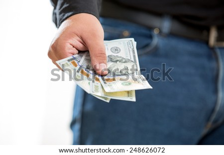 Closeup photo of man showing hand with hundred dollar banknotes - stock photo