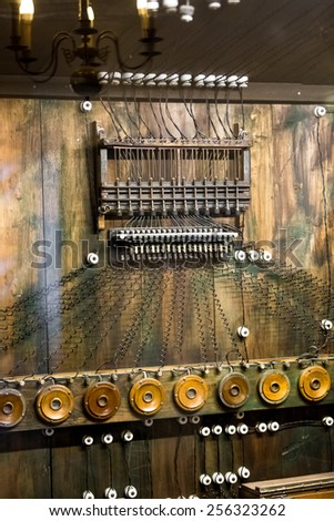 Closeup photo of old telephone commutator with a lot of wires - stock photo