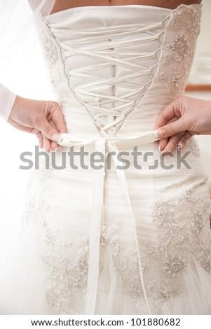 closeup photo of ribbon on brides dress - stock photo