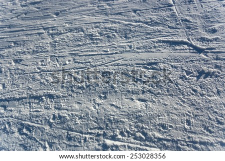 Closeup photo of skis marks on snow slope - stock photo