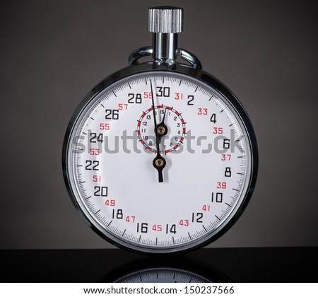 Closeup Photo Of Stopwatch On Gray Background - stock photo