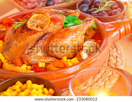 Closeup photo of tasty baked Thanksgiving turkey with fresh green parsley, delicious traditional food for autumn holiday, healthy eating concept - stock photo