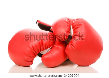 closeup photo of the boxing gloves with reflection on a white background - stock photo