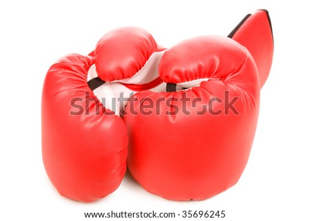 closeup photo of the boxing gloves with shadow on a white background