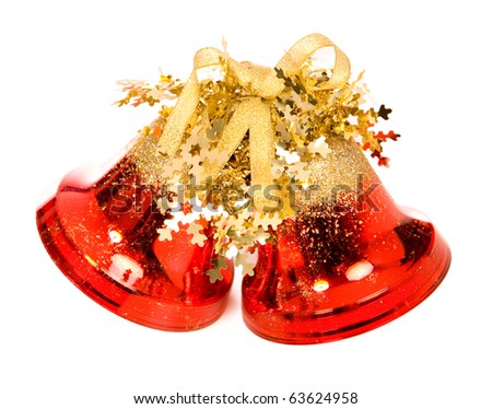 closeup photo of the christmas bells with shadow on a white background