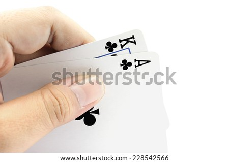 Closeup photos that focuses on the black jack with King card and ace card of clubs in the hand on white background - stock photo