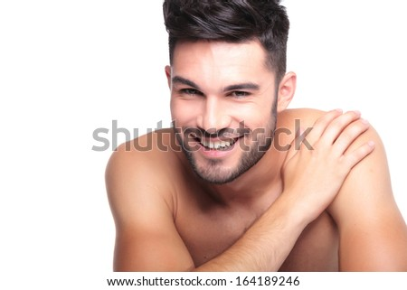 closeup picture of a smiling naked man with hand on his shoulder on white background - stock photo