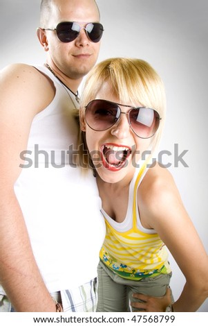 closeup picture of a young woman screaming near her boyfriend