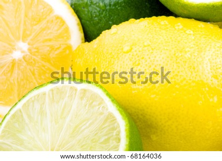 Closeup picture of lemon and lime - stock photo