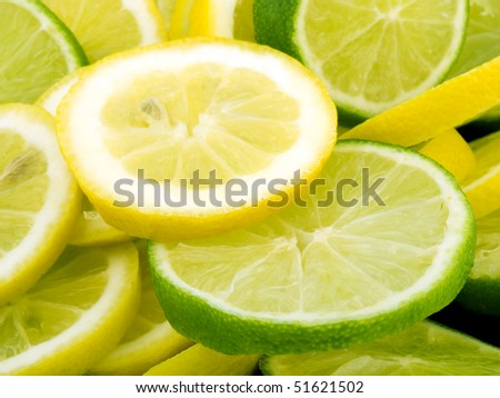 Closeup picture of lemon and lime slices. - stock photo