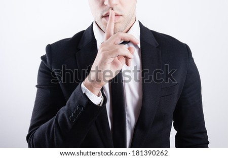 closeup picture of man making a hush gesture - stock photo