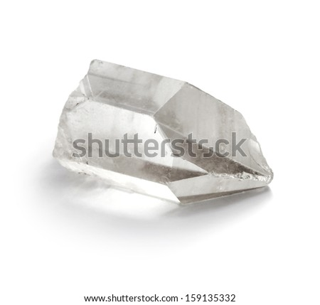 Closeup picture of pure quartz (crystal rock) mineral gemstone isolated on white background.  - stock photo