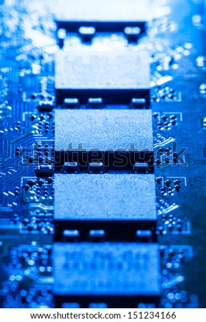 Closeup picture of some computer parts in blue light