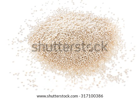 Closeup pile of raw uncooked amaranth seed on white background - stock photo