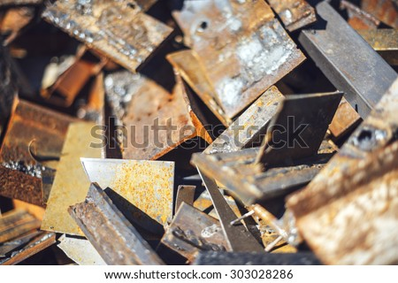 Closeup pile of scrap metal junk garbage. texture background - stock photo
