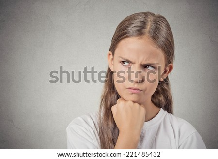 Closeup portrait angry grumpy teenager girl displeased jealous looking to side isolated grey wall background. Negative human emotions facial expression feeling attitude reaction body language - stock photo